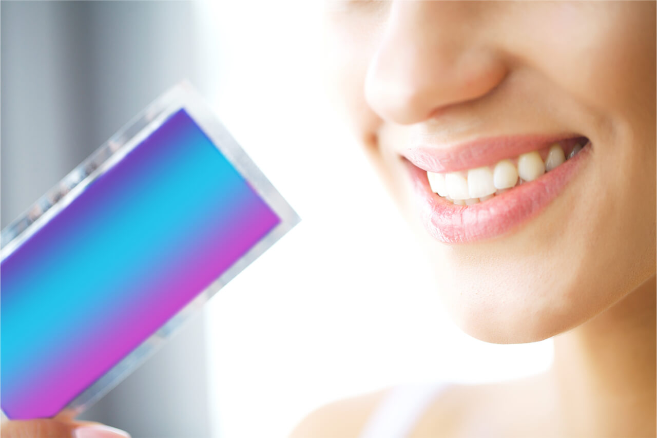 how do teeth whitening strips work